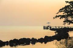 Tropical Resort Deckchair at sunset. Woman seating in the Tropical Resort Deckchair at sunset Stock Photography