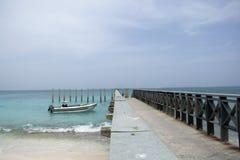 Tropical resort destination. Tropical resort destination dock pier with little boats Stock Photo