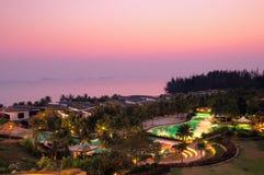 Tropical resort at dusk Stock Photo