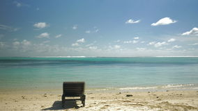 Tropical resort and empty deck-chair by ocean stock video