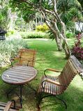 Tropical resort garden. A photograph image of the peaceful outdoor gardens of a tropical resort in Bali, Indonesia.  Showing outdoor furniture of wood and iron Royalty Free Stock Images