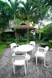 Tropical resort garden with furniture. An image of the outdoor patio area and shady gardens of a tropical resort in Bali, Indonesia.  Showing simple furniture of Stock Images