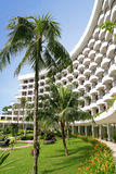 Tropical Resort Hotel 02. Image of a tropical resort hotel with green and beautiful landscaping Stock Photo