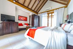 Tropical resort or hotel beach villa, superior bedroom. Exotic destination, tropical beach villa or bungalow, natural looking furniture elements royalty free stock photos