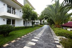 Tropical Resort Hotel. Image of a tropical resort hotel with green and beautiful landscaping Stock Photo