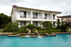 Tropical Resort Hotel. Image of a tropical resort hotel with green and beautiful landscaping Royalty Free Stock Images