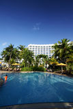 Tropical resort hotel swimming pool Royalty Free Stock Image