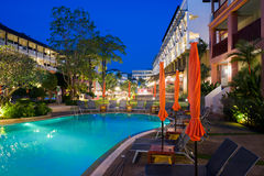 Tropical resort hotel. With a swimming pool in the evening Royalty Free Stock Photos