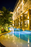 Tropical resort hotel. With a swimming pool at night Stock Photo