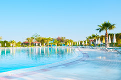Tropical resort hotels. With beautiful pool in foreground Royalty Free Stock Photography
