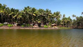 Tropical resort in India. Tropical resort whith lagoon in Goa, India stock video