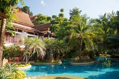 Swimming pool at a resort in Phuket, Thailand. Nice green garden suronding-2 Royalty Free Stock Photography