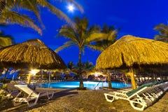 Tropical resort at night. Tropical resort with swimming pool at night Royalty Free Stock Photo
