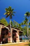 Tropical resort on ocean shore. Luxury tropical resort on ocean shore with palm trees Stock Images