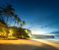 Tropical resort, palm and coast of Thailand beach. Night view of tropical resort, palm trees and sand coast of Thailand beach Royalty Free Stock Photography