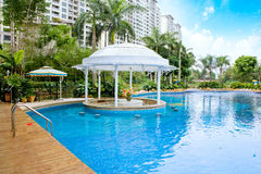 Tropical resort pool. Tropical resort with a luxury pool Royalty Free Stock Photos