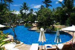 Tropical resort with pool. Tropical resort with swimming pool Royalty Free Stock Photos