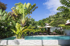 Tropical resort pool garden in kep cambodia. Tropical resort swimming pool garden in kep cambodia Royalty Free Stock Image