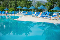 Tropical Resort Pool with Lounge Chairs Stock Images