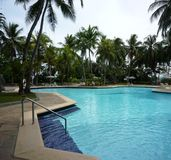 Tropical resort pool side Royalty Free Stock Photos