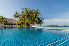 Tropical resort poolside with sea background Royalty Free Stock Images