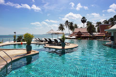 Tropical resort. Poolside and sea view Stock Images