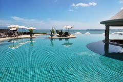Tropical resort. Poolside and sea view. Tropical resort. Poolside with beautiful sea view Royalty Free Stock Photo