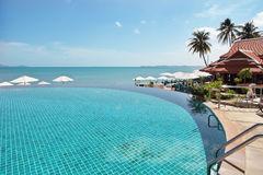 Tropical resort. Poolside and sea view. Tropical resort. Poolside with beautiful sea view Stock Photography