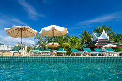 Tropical resort scenery in Thailand. Tropical resort with swimming pool scenery in Thailand Royalty Free Stock Images