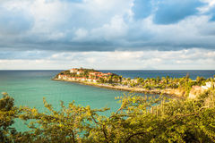 Tropical resort of Sint Maarten built near ruins of the Fort Ams. Philipsburg, Sint Maarten April 6, 2017: Tropical resort on the island built near the ruins of Stock Photos