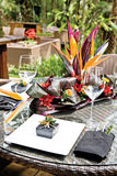 Tropical resort style table setup Royalty Free Stock Photography