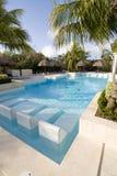 Tropical Resort swiming pool. Large swiming pool in a tropical resort Stock Photos