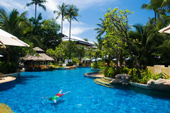 Tropical resort with swimming Royalty Free Stock Photography