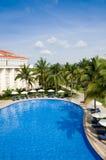 Tropical resort swimming pool Royalty Free Stock Photos