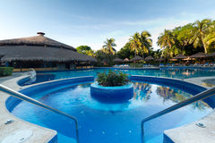 Tropical resort at swimming pool Royalty Free Stock Images
