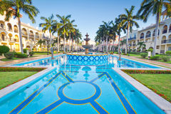 Tropical resort with swimming pool stock image