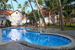 Tropical resort with swimming pool Stock Photography