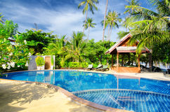 Tropical resort with swimming pool Royalty Free Stock Photography