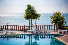 Tropical resort swimming pool overlooking sea. Koh Royalty Free Stock Photos