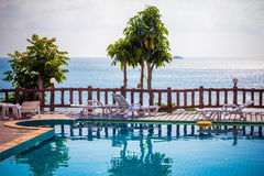 Tropical resort swimming pool overlooking sea. Koh Stock Photos