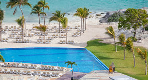 Tropical resort swimming pool overlooking sea Stock Image