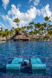 Tropical resort swimming pool in Punta Cana Royalty Free Stock Photos