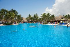 Tropical resort swimming pool at the Riviera Maya. Near Cancun. Photo taken during in Playa Aventuras, Mexico, on July 3, 2011 stock photo