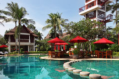 Tropical resort in thai style. Poolside restaurant Stock Photo