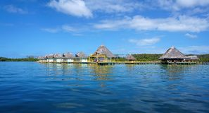 Tropical resort with thatched bungalows Stock Photo