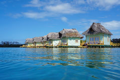 Tropical resort with thatched overwater bungalow Stock Photography