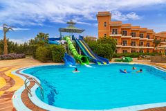 Tropical resort Three Corners Sunny Beach hotel. HURGHADA, EGYPT - APR 9, 2013: Tropical resort Three Corners Sunny Beach in Hurghada on 12 April 2013. Three Stock Photo