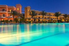 Tropical resort Three Corners Sunny Beach hotel. HURGHADA, EGYPT - APR 9, 2013: Tropical resort Three Corners Sunny Beach in Hurghada at dusk. Three Corners is Royalty Free Stock Images