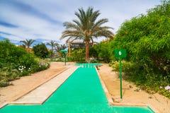 Tropical resort Three Corners Sunny Beach hotel. HURGHADA, EGYPT - APR 9, 2013: Mini golf of Three Corners Sunny Beach in Hurghada on 12 April 2013. Three Royalty Free Stock Images