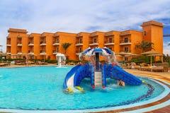 Tropical resort Three Corners Sunny Beach hotel. HURGHADA, EGYPT - APR 9, 2013: Tropical resort Three Corners Sunny Beach in Hurghada on 12 April 2013. Three Stock Images